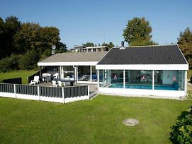 Four Bedroom Holiday Home In Ebeltoft 18 photos Exterior