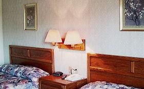 Brass Bell Inn And Suites