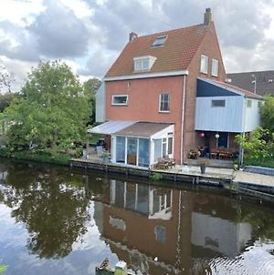 Characteristic Detached House Next To Water photos Exterior