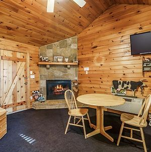 Country Getaway Hot Tub Heart Shaped Jetted Jacuzzi Stone Gas Log Fireplace Rocking Chairs photos Exterior