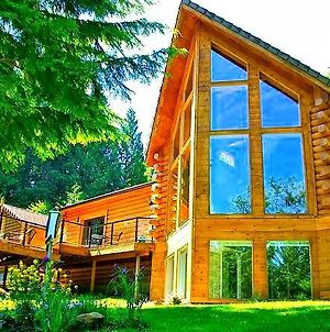 Luxurious Riverfront Log Home Estate photos Exterior