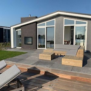 Modern Chalet With Jetty And Terrace Near The Oosterschelde photos Exterior