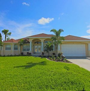 Luxurious 4 Bedroom, With 2 Master Suites, 4 Baths, Heated Pool And Spa Home Located On A Canal. photos Exterior