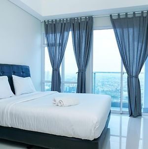 Simply Furnished Studio Apartment At Puri Mansion By Travelio photos Exterior